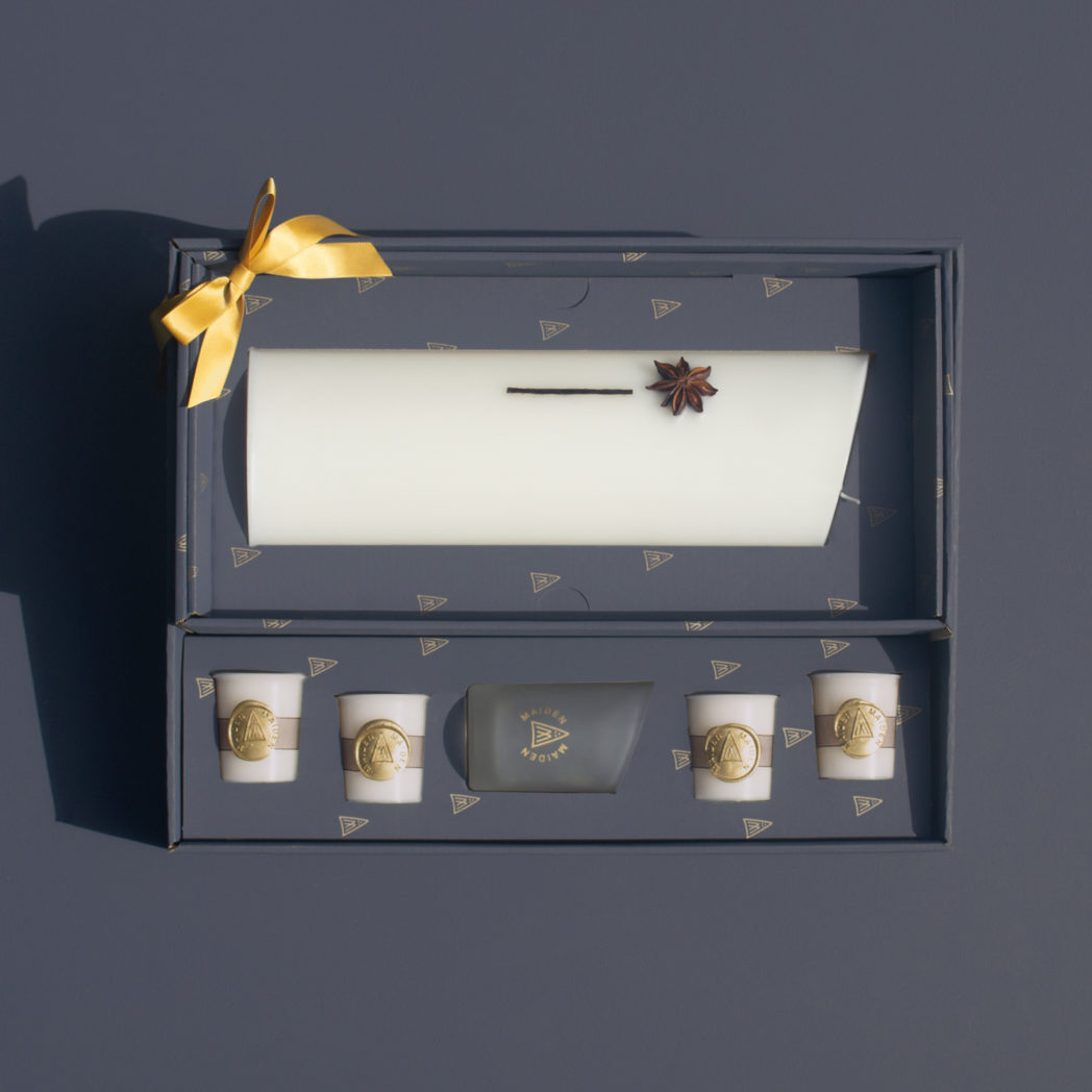 star anise curve candle in gift set with gold bow votive glass and votive candles decorative with gold wax seal